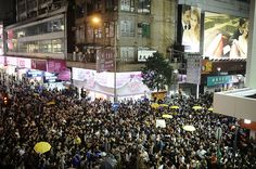 Umbrella Revolution Hong Kong, Pro-democracy protesters gather at Sai Yeung Choi Street at Mongkok district on November 29, 2014 in Hong Kong, Hong Kong. The night before, pro-democracy protesters clashed with police forces on Sai Yeung Choi Street at Mongkok district. 28 people were arrested. (Photo by Alexander Koerner/Getty Images)
