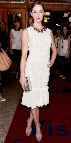 Look of the Day - September 11, 2012 - Emily Blunt WHAT SHE WORE For the Toronto International Film Festival premiere of Arthur Newman, Blunt sported a Tory Burch dress made of reclaimed silk tulle and a recycled brass necklace, also from the designer. She finished the look with strappy sandals and Graziela brown and white diamond studs.