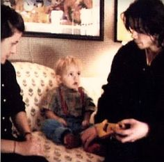 Michael Jackson with his son Prince, not sure who the other person is.