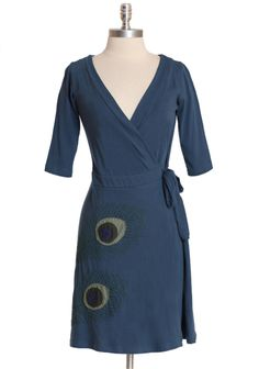 Peacock Quills Wrap Dress By Synergy  74.99 at shopruche.com. Designed in organic cotton, this soft wrap dress in dusty blue features a flattering silhouette with a stitched peacock feather design.100% Cotton, Imported, 37'' length from top of shoulder