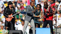 Musicians Carlos Santana, Alexandre Pires and Wyclef Jean perform during the closing ceremony.