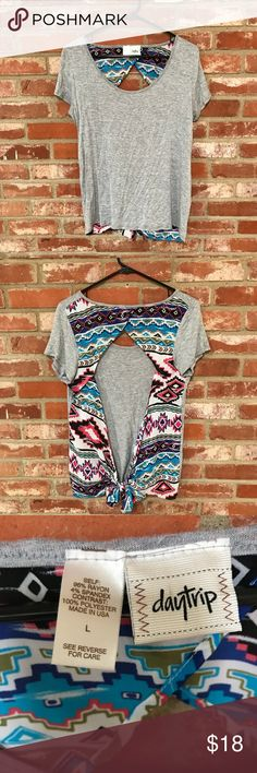 Daytrip open back mixed material top (16) Cute open back top size Large fits more like a medium but can be adjusted since the back ties. Worn and washed once. Excellent condition! 19 inches armpit to armpit  24 inches long I accept reasonable offers! Bundle multiple items for a private offer 💜 The more you buy the more you save 👗 Daytrip Tops Tees - Short Sleeve