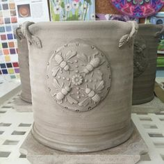 Working on a new utensil holder style with a bee mandala for decoration.
