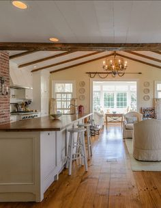 I love this white kitchen. Bright yet warm too!!