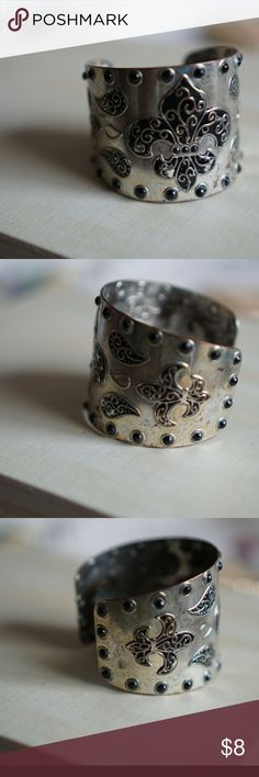 Fleur-de-lys Studded Silver Bracelet Lovingly used. Tarnished and parts of silver paint rubbed off.  No brand babe available. Reasonable offers welcome! (See chart at top of my Closet) Lowball offers soil be countered with my lowest acceptable price.  Ask all questions before purchasing. Additional pics provided upon request. No trades. Jewelry Bracelets
