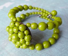 DIY: Green Beaded Cuff Bracelet ... I play have to play around with this idea... different beads though ....