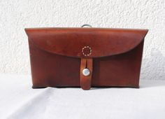 Vintage Swiss Army Leather Ammunition Bag, Beltbag, Ammo Pouch from 1967 by SwissvintageandMore on Etsy https://www.etsy.com/listing/475063578/vintage-swiss-army-leather-ammunition