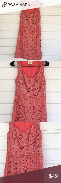 """Anthro Maeve Coral Shimmer Floral Eyelet Dress Anthro Maeve Coral Shimmer Floral Eyelet Dress Beautiful subtle shimmer over a vivid coral pink. Daisy pattern open work eyelet, lined. Excellent condition, side zip. Offers always warmly received.  16"""" from underarm to underarm, 36"""" from shoulder to hem. Lovely and charming, perfect for a feminine spirit with a no nonsense attitude. Anthropologie Dresses"""