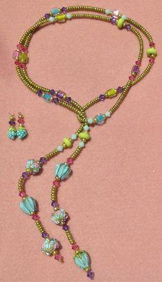 Heather Davis flower beads pearls ,cane glass, swarovski crystals.