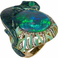 Ilgiz Fazulzianov. Not a style I typically like but this is a gorgeous ring, great craftsmanship, a little world on your finger.