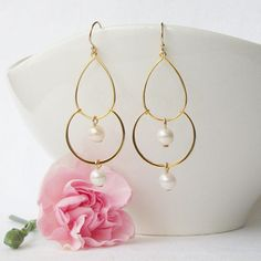 Beautiful and Unique Pearl Chandelier Dangle Earrings. Earrings are made, gift wrapped and ready to ship. All orders include tracking. Plastic safety ear nuts included.  Thank you for stopping by Perini Designs Studio http://www.etsy.com/shop/PeriniDesigns Copyright on all original designs and photographs held by artist. Jewelry not intended for children 12 and under.