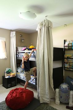 Bed fort curtains.  I've been trying to figure a way to do this for a while now.  I know the boys would love it.