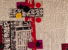 "Detail of contemporary art quilt, embellished with buttons - ""Graffiti"""