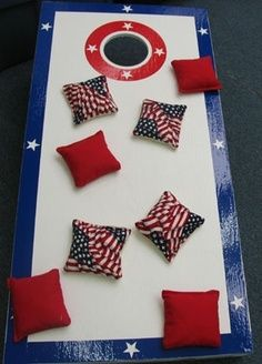 4th of July Décor-  mmmm- why not a laundry basket? Love the pillows- too cute to resist! Fill them with beans?