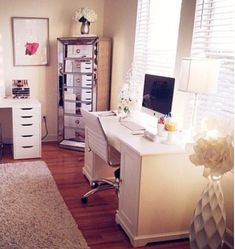 Love all the organization going on here. Different desks for work and crafts. Beautiful additional storage with the tall mirrored dresser drawers and an open floor to move around. Complete with neutral tones that are soothing to the eye and help create a calming office space!