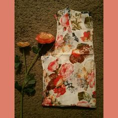 Chiffon Floral Sleeveless Blouse NWT! Extremely elegant. Very soft material, and lightweight.  Perfect for hot summer days and nights. Measurements are as follows: Bust 35 Tops