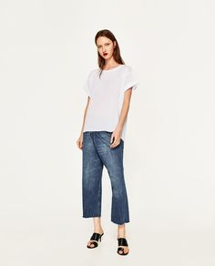 Image 1 of T-SHIRT WITH ROLLED-UP SLEEVES from Zara