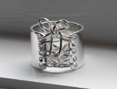 Sterling Silver Wide Band Wired Corset Ring with Bow    FREE SHIPPING. $89.00, via Etsy.