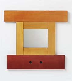 ETTORE SOTTSASS JR Unique prototype framed mirror, 1960  Stained birch, mirrored glass. 40.5 x 40 x 2 cm. (16 x 15 3/4 x 3/4 in.)
