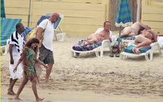 I remember this, lmfao. Isn't it illegal to have cameras on nude beaches? What was this particular pap thinking?