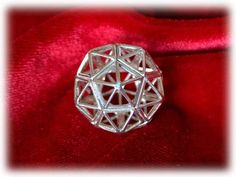 Christ consciousness - silver - Sacred Geometry symbol for Healing. Also called - Christ grid pendant This beautiful sacred geometry structure is a combination between two of the Perfect Platonic Solids the Icosahedron and the Dodecahedron.   Each facet of a dodecahedron is actually a pentagon/pentad.  The pentad was so revered to early Greek philosophers and the disciples of Pythagoras that its construction and its divine proportions were kept secret.