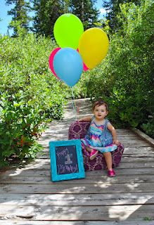 First 1st Birthday Pictures! :) AVERY QUINN  we need to find a spot to do pics and i could bring her pink polka dot chair she got for christmas with balloons!