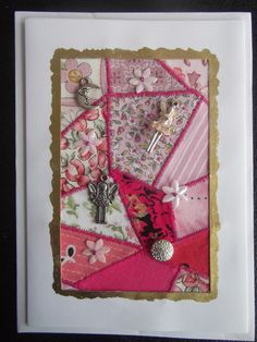 Fabric card made from scraps left over from patchwork, embellished with silver charms.