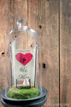 Use a glass cloche to make a beautiful and long-lasting Valentine's Day present.