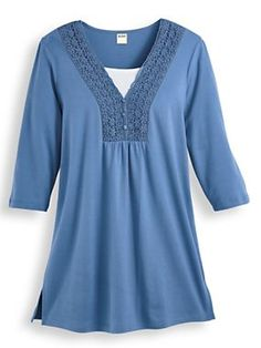 Layered-Look Tunic - <p> A pretty touch of lace adds charming dimension to this knit essential. Lace and decorative buttons accent the V-shaped neckline. Solid white ins