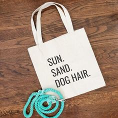 Sun. Sand. Dog Hair. It's the perfect tote bag for your next trip to the beach! These simply designed canvas tote bags will be the shopping bag you reach for time and time again. They are roomy enough to hold all your essentials but not so large that you feel like you're lugging a suitcase around. Made from lightweight cotton canvas, they are not only durable but both classic and trendy. 10% of your purchase is donated to help dogs in need at local animal shelters. Dog Mom Gifts, Dog Lover Gifts, Dog Lovers, Dog Tote Bag, Dog Hacks, Crazy Dog, Dog Accessories, Canvas Tote Bags, Cute Babies