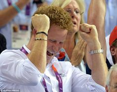 One gold down, two to go: Harry looks as thrilled with Trott's win as anyone in the 6,000 capacity velodrome