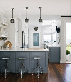 blue-gray and white kitchen Australian design firm Coco Republic Interior Design via Emily A Clark