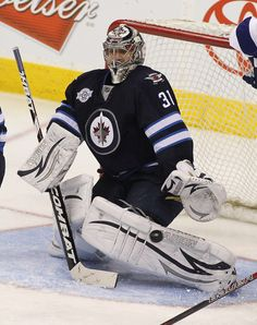 WINNIPEG, CANADA - APRIL 7: Ondrej Pavelec #31 of the Winnipeg Jets watches as the puck goes in on a shot by Steven Stamkos #91of the Tampa Bay Lightning. The goal was his 60th goal  in NHL action at the MTS Centre on April 7, 2012 in Winnipeg, Manitoba, Canada. (Photo by Marianne Helm/Getty Images)