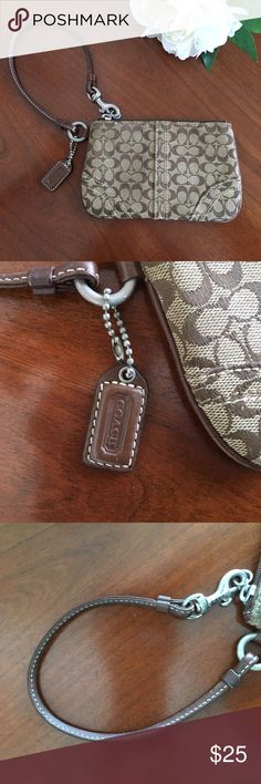 Coach Signature brown wristlet w/ leather accents Brown coach Signature wristlet with brown lining and brown leather accents. VGUC. Smoke free dog friendly home. 6.5x4 inches with 5.5 inch strap Coach Bags Clutches & Wristlets