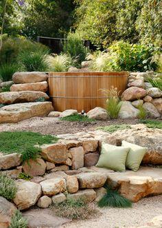 cherokee creek boulders - dry staked retaining wall - boulder steps - cedar spa - boulder bench - pillows - grasses