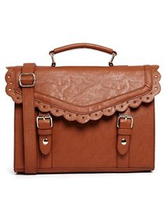 "ASOS Vintage Style Punchout Satchel Bag Cart By ASOS Collection  100% Polyurethane Leather-look fabric Textured matte finish Flap front, scalloped trim Grab handle Magnetic strap fastenings Internal zip pocket H: 21cm/8"" W: 30cm/12"" D: 10cm/4"" Strap drop one: 4cm/2"" Strap drop two: 53cm/21"" Wipe clean $47.67 Color: Tan"