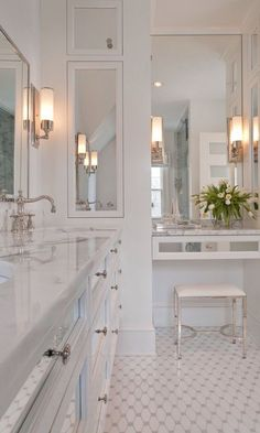 This all-white bathroom is very traditional…and very luxurious. It has been carefully planned from the inbuilt marble-topped dressing table to the inset sinks and chrome taps. Everywhere you look, it is filled with carefully-considered touches.