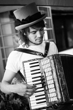 Ben Lovett- Mumford and Sons. I want to learn how to play accordion because of him.
