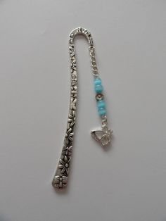 Large patterned silver bookmark with blue bead & silver butterfly pendant
