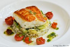 seared halibut w/ couscous, escabeche of vegetable & oven dried tomato dressing