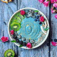 Blue Smoothie bowl by @sculptedpilates    Recipe:  Blend 3 frozen bananas, 4 blackberries, 3 tbsp of coyo mixed with 2 scoops of Bluemajik, 1/2 of almond milk and two medjool dates. Enjoy! #letscookvegan