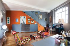 Fabulous colorful chairs surrounded by orange and grey room