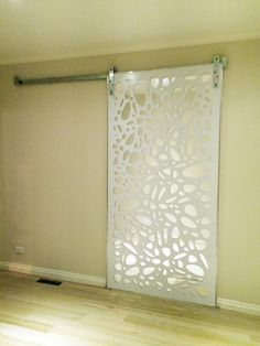 Decorative screens make beautiful sliding doors. This is QAQ's 'Cayman' design on mirrored ACM.