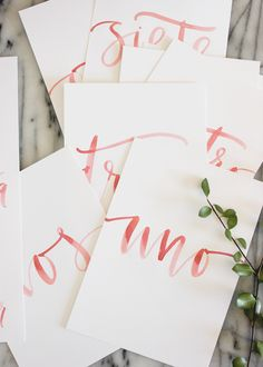 I love everything about these table numbers...color, calligraphy, white, clean, and simple without losing its edge.