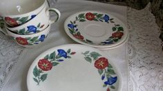 Certainly would look pretty at any table, Absolutely must use weekend set. Vintage 8pc Tea set  ~ Shenandoah, white tea set. Pattern: Morning Glory ~ Design is pretty red and blue morning glories, with green foliage. ~ Set of includes: 3 teacups, 2 saucers, 3 bread/butter plates