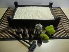 This Pillar Style Zen Garden is small enough to fit on almost any desk or table top at home or in your office. It only measures 2 3/4H x 8W x 10 1/2L. Although desk top Zen gardens are small in size they can provide and help you experience the same tranquility as the outdoor gardens. This Zen garden is made from poplar and pine wood and assembled without screws or nails. The edges of the base have routed grooves and the walls slide into place and glued. In some cultures these garden...