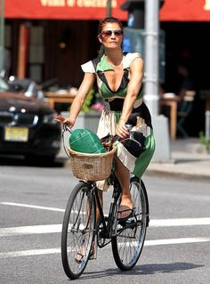 Helene Christensen running errands on a bike- she's got goods in the basket