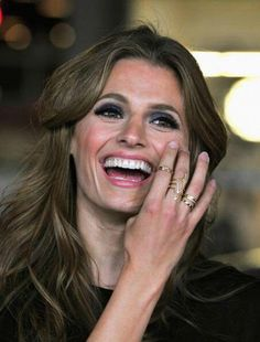 Stana Katic. I like to see untouched photos to remind us that no one is perfect.