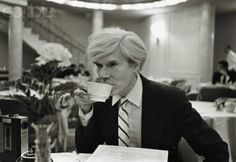 29 May 1981, Manhattan, New York City, New York State, USA --- Andy Warhol drinks a cup of coffee while sitting in the dining room of New York's Hotel Pierre. --- Image by © Robert Levin/CORBIS