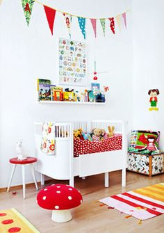 .bright colors against white. Round crib. Rabbit lamp. Mushroom crochet toadstool by Anne-Claire Petit. Christine Bauer - Fotografie - Interiors Modern.  Great colours in this nursery, children's shelving and bright accessories.